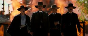 Tombstone cowboys walking from fire